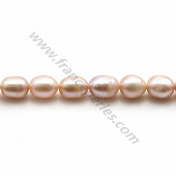 Pinkish oval freshwater pearls on thread 6-7mm x 40cm